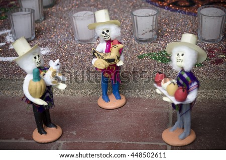 OAXACA, OAXACA, MEXICO- NOVEMBER 2, 2015: Skulls dressed with traditional clothes, part of a day of the dead offering altar in Oaxaca, Mexico - stock photo