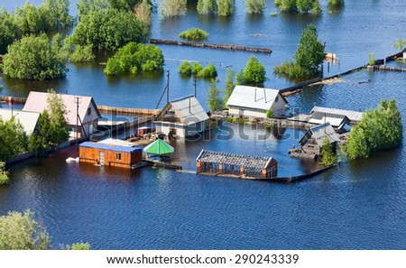 Ob River Flood June 2015 Aerial View of same houses in vicinity of Nizhnevartovsk, Tyumen region, Russia. Aerial view of the residential area of the suburb of Nizhnevartovsk during the flood of 2015. - stock photo