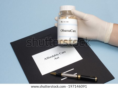ObamaCare prescription bottle with Affordable Care Act folder. - stock photo