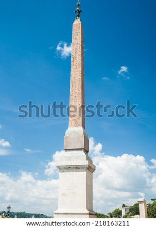 Obelisco Sallustiano. The obelisk crowns the world famous Spanish Steps in front of the church Trinita dei Monti. - stock photo