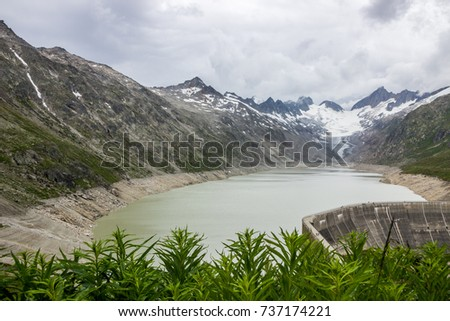 Oberaar panoramic mountain road and glacier in Switzerland in Alps