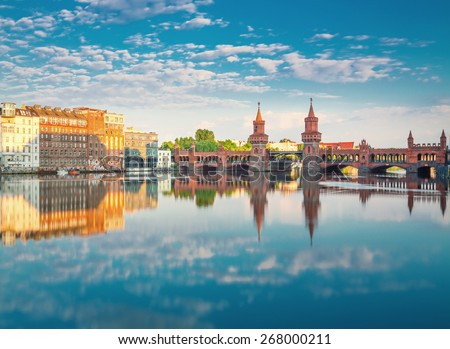 Oberbaumbruecke Berlin Summer with Reflection and Clouds - stock photo