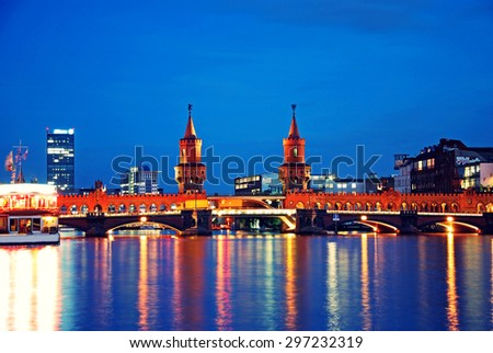 oberbaumbruecke bridge in berlin kreuzberg at night - stock photo