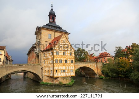 Obere bridge (br���¼cke) and Altes Rathaus and cloudy sky in Bamberg, Germany  - stock photo