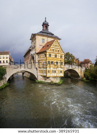 Obere bridge (br�¼cke) and Altes Rathaus and cloudy sky in Bamberg, Germany