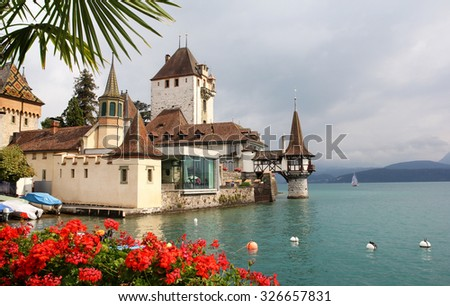 Oberhofen Castle on the Thun Lake, Canton Bern, Switzerland - stock photo