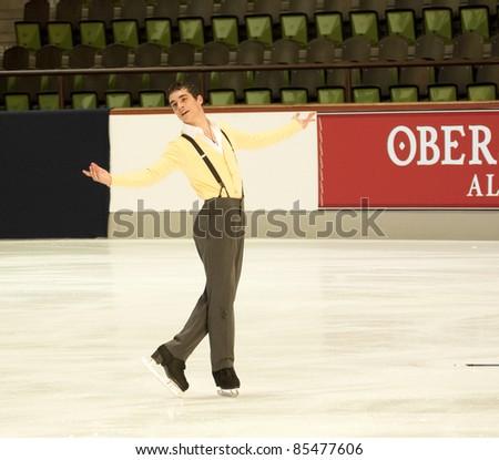 OBERSTDORF, GERMANY - SEPT 22: Figure skater Javier Fernandez of Spain performs his short program at Nebelhorn Trophy on September 22, 2011 in Oberstdorf, Germany - stock photo