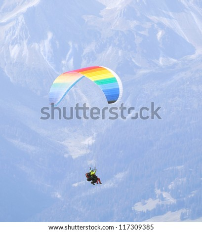 OBERSTDORF - SEPT 23: Dozens of tourists participate in recreational tandem paragliding, taking off from The Nebelhorn, a mountain in the Allgau Alps, on September 23, 2012 in Oberstdorf, Germany