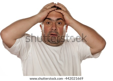 obese amazed man on a white background