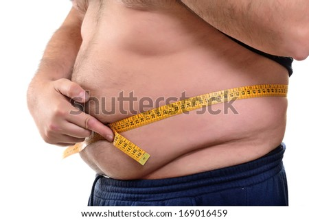 Obese man measuring his belly overweight - stock photo