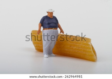 obesity concept with a miniature of a fat man - stock photo