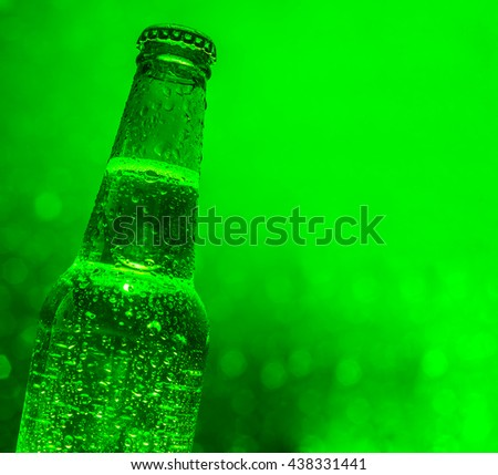 object of Fresh cold green beer bottle with drops and metal cover on beautiful bokeh dark and luxury light background Nice Photo image for advertising