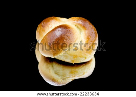 object on black - food roll with jam
