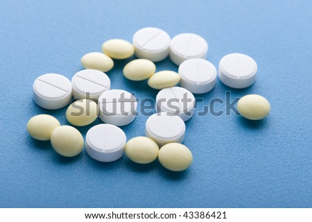 object on blue - medical Tablet close up