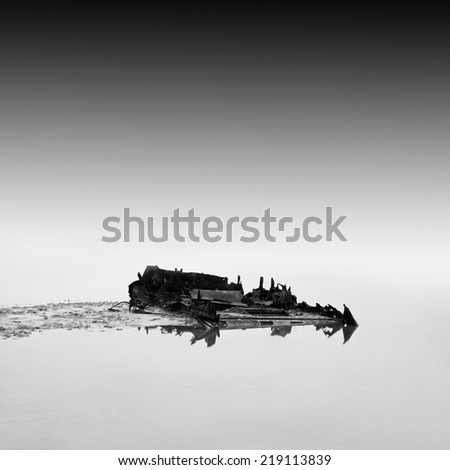 Object on the sea. Black and white tones. Long exposure daytime shot. Odessa, Ukraine - stock photo