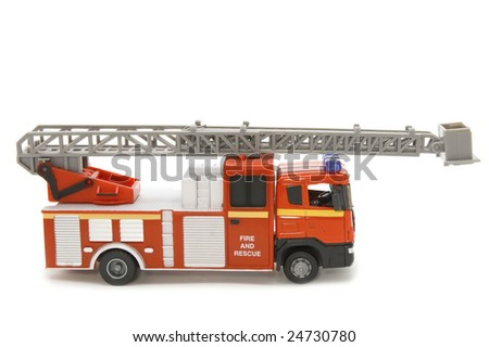 object on white - toy fire fighting vehicle - stock photo