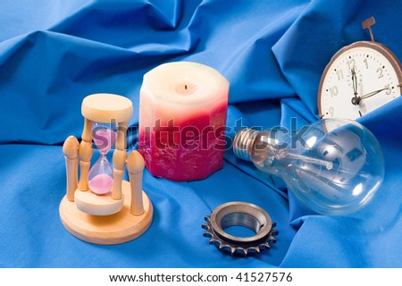Objects of time and light, low depth of field, focus on cog - stock photo