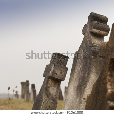 Oblique tombstones in old cemetery, Hungary - stock photo