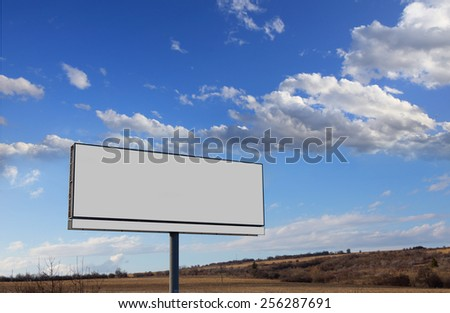 Oblong blank white billboard and sky with clouds