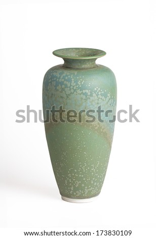 oblong green and teal vase speckled with gold isolated on a white background