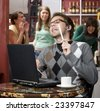 Obnoxious young man singing loudly in a coffee house - stock photo