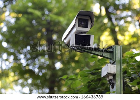 Observation camera on a column in the park - stock photo