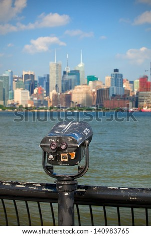 Observation deck with binoculars, view of New York city, Manhattan buildings - stock photo
