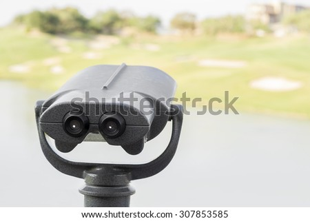 Observation point looking out at dramatic golfers tee viewpoint over lake to agree surrounded by bunkers. - stock photo