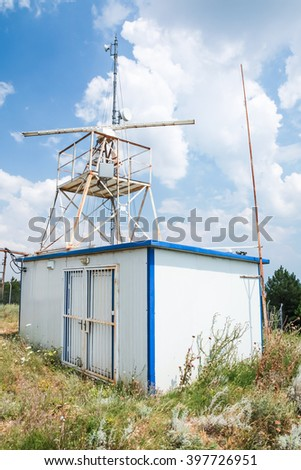 Observation radar station tower with antenna devices and cameras - stock photo