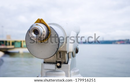 Observation telescope pointed to the beautiful 25 de Abril Bridge - stock photo
