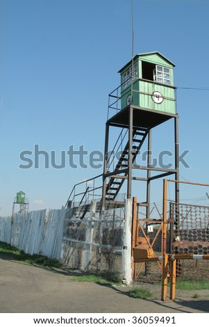 Observation tower at the prison - stock photo