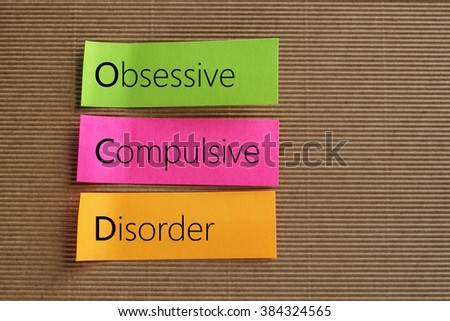 Obsessive Compulsive Disorder (OCD) text on colorful sticky note - stock photo