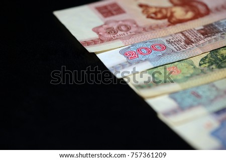 Obsolete Belarusian banknotes on a dark background close up