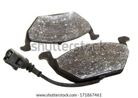 Obsolete car brake pads whit sensor and cable isolated over white background - stock photo