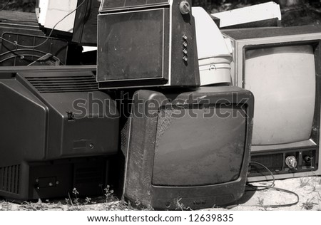 Obsolete or broken television stacked for disposal - stock photo