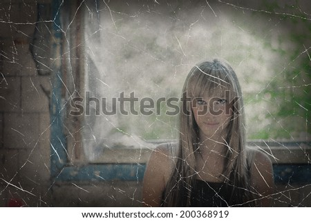 Obsolete photo of a blond haired women against window.