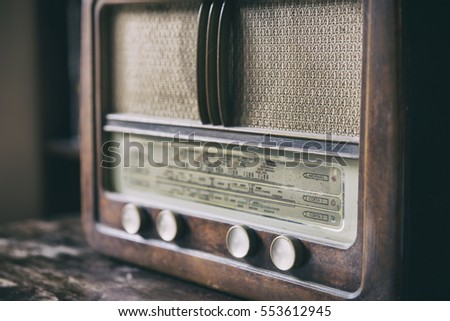 Obsolete radio in wooden case. Horizontal indoors shot
