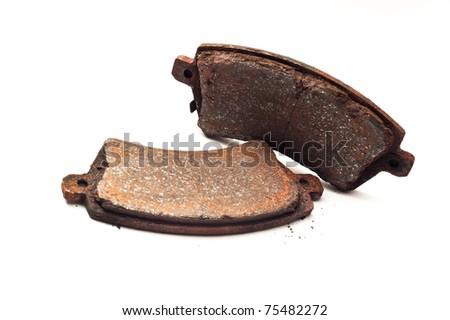 Obsolete rusty car brake bads isolated on white background - stock photo