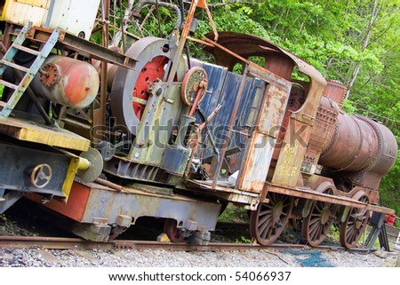 Obsolete 1920's steam locomotive in a siding at Bitton on the disused railway formerly linking Bristol and Bath UK - stock photo