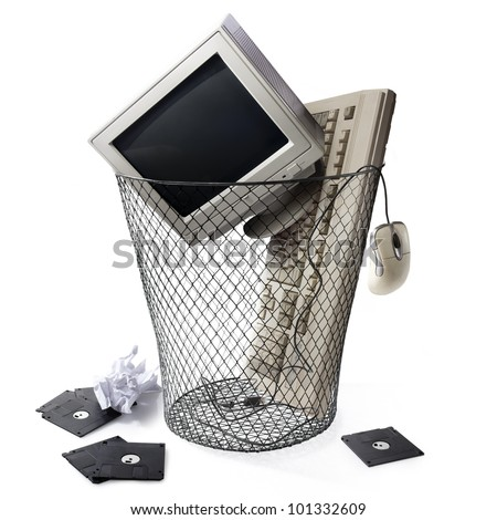 obsolete technology concept with a trashcan - stock photo
