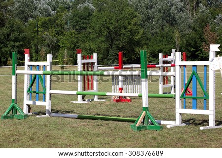 Obstacles and barriers in row on a horse jumping show - stock photo