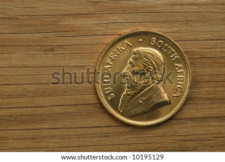 Obverse of gold South African Krugerrand coin, one ounce pure gold - stock photo
