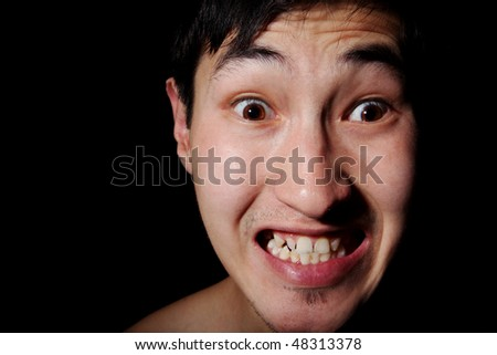 Obverse portrait of the Asian man, aggression, rage, emotions - stock photo