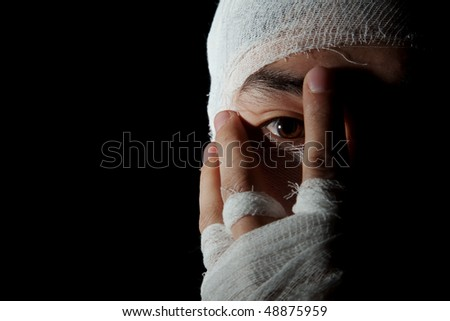 Obverse portrait of the young man which head is wound by bandage - stock photo