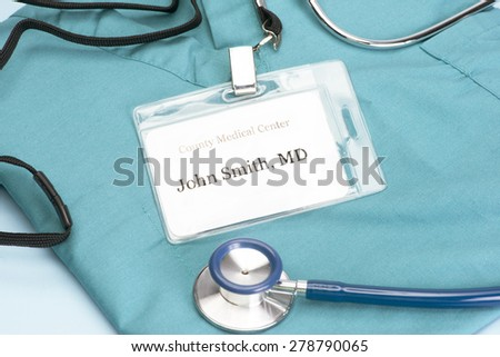 Obviously fictitious Doctor identification tag on scrubs with stethoscope. - stock photo