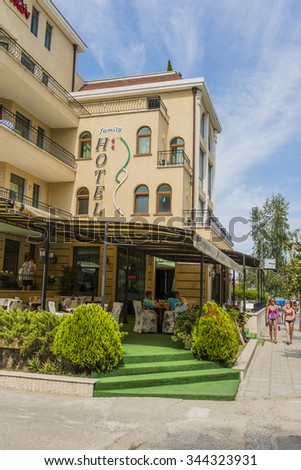 OBZOR, BULGARIA - AUG 10, 2015: Family Hotel. Tourists walk during a summer vacation on sea. Architecture and streets of the town of Obzor in Bulgaria. Picture taken during a trip to Bulgaria.
