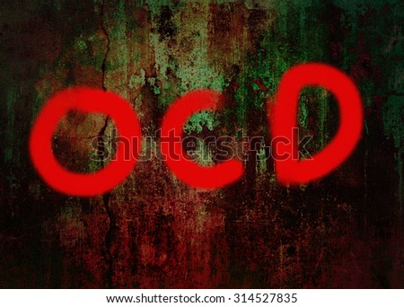 OCD ( Obsessive compulsive disorder) word hand drawing on grunge background - stock photo