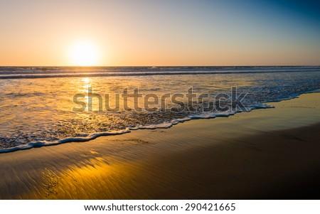 Ocean and beach at sunset. California Coast - stock photo