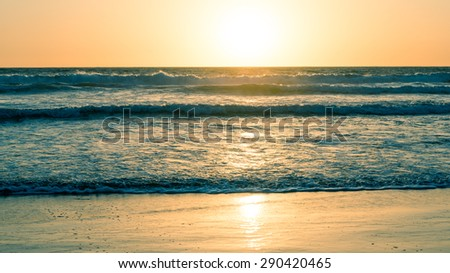 Ocean and beach at sunset. California Coast. Abstract seascape background. Original film shot. - stock photo