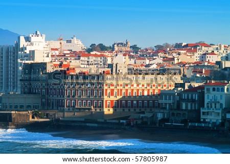 ocean and city, blue sky - stock photo